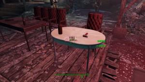 Столик с журналом подсвечен красной лампой